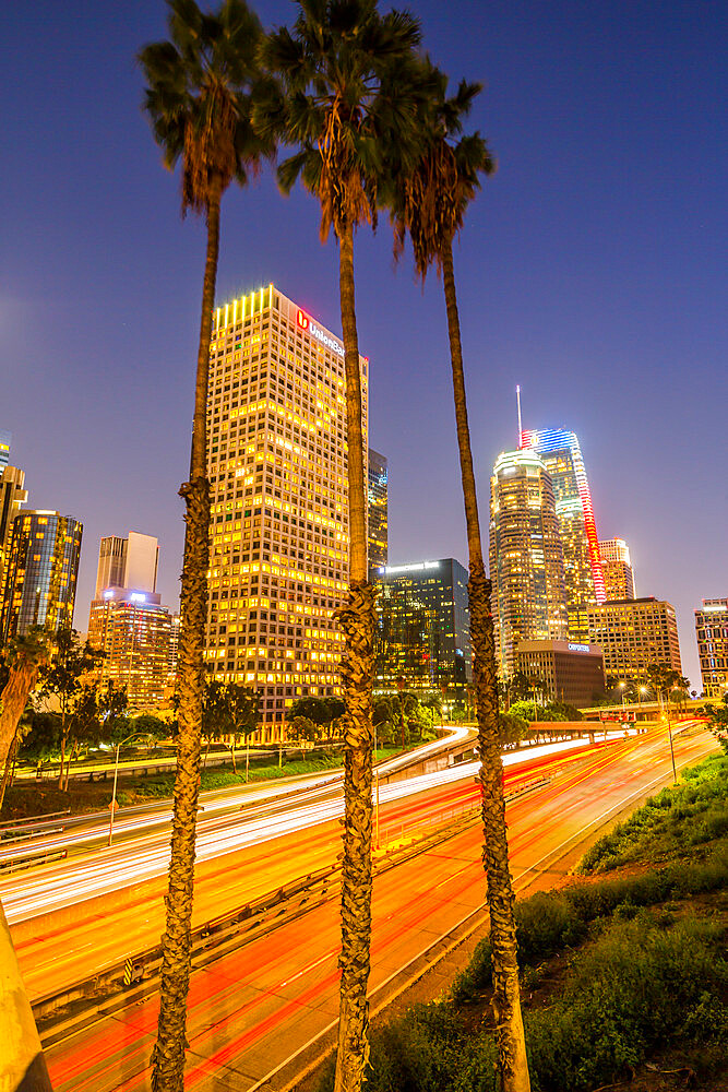 View of Downtown skyline and Harbour Freeway at dusk, Los Angeles, California, United States of America, North America