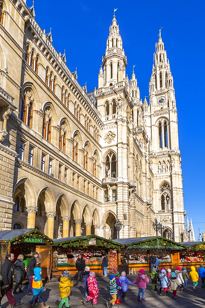 View of Rathaus and Christmas market stalls in Rathausplatz, Vienna, Austria, Europe