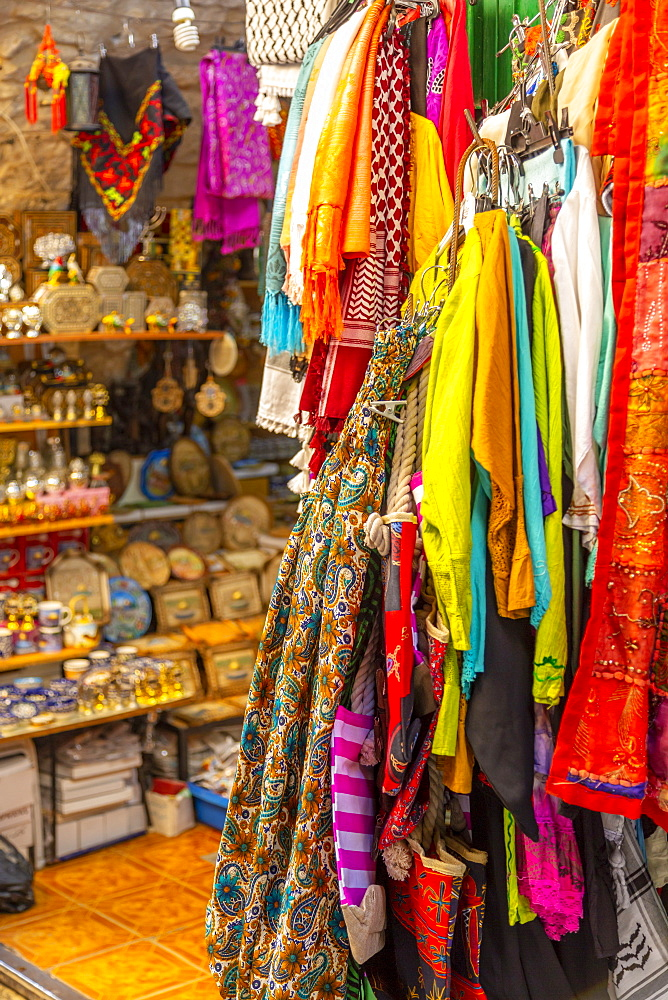 Colourful garments, Souk Khan al-Zeit Street in Old City, Old City, UNESCO World Heritage Site, Jerusalem, Israel, Middle East