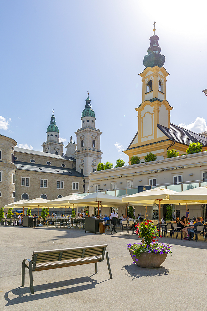 View of St. Michaelskirche and Salzburg Cathedral in Residenzplatz, Salzburg, Austria, Europe