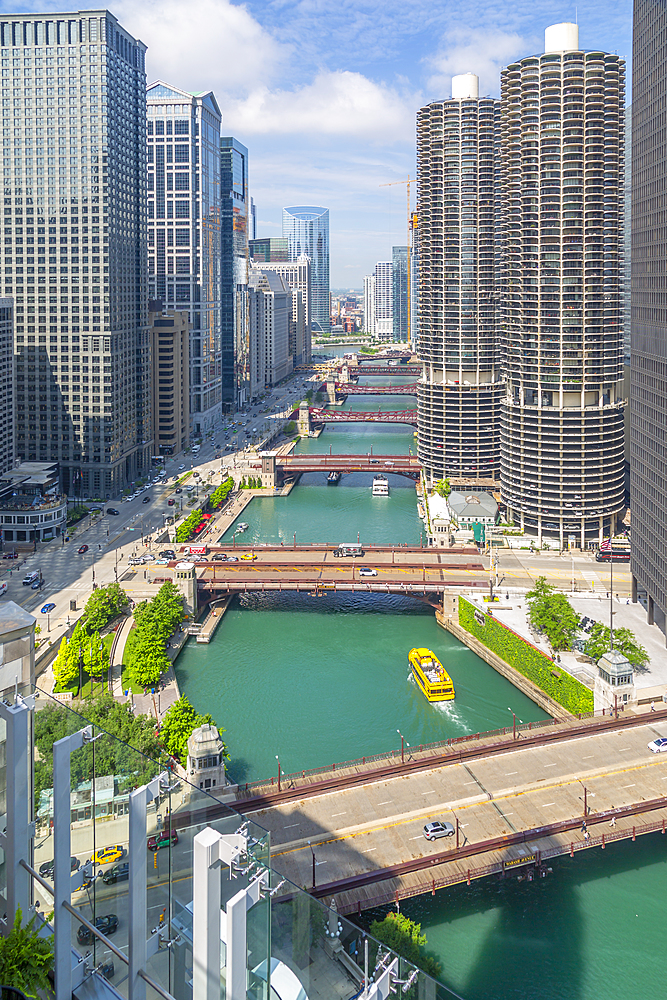 View of Water Taxi on Chicago River from rooftop terrace, Downtown Chicago, Illinois, United States of America, North America