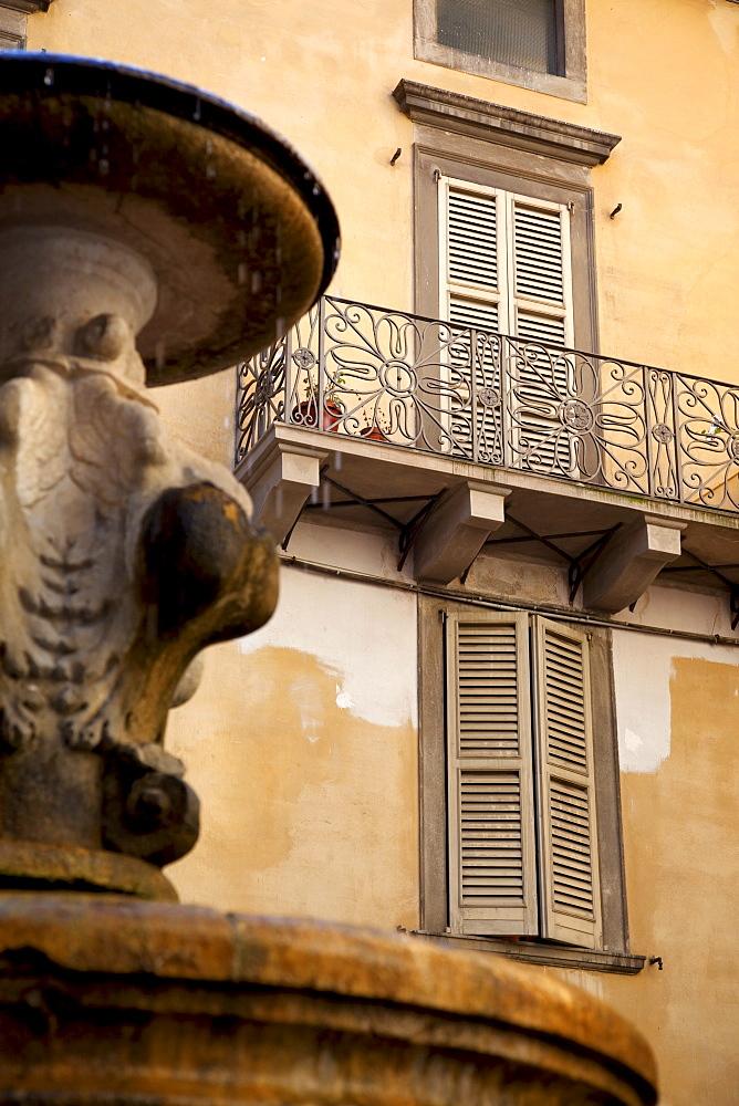 Shuttered windows and fountain, Bergamo, Lombardy, Italy, Europe