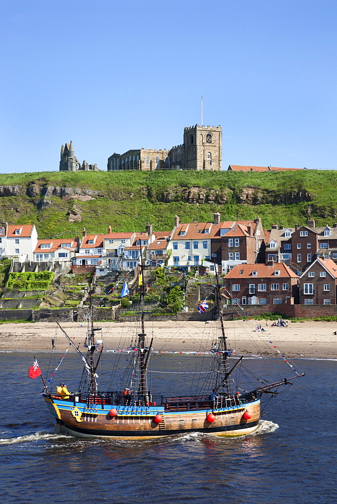 Pleasure ship below Whitby Abbey and St. Marys Church, Whitby, North Yorkshire, Yorkshire, England, United Kingdom, Europe