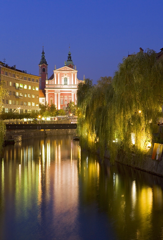 The Church of the Annunciation on the Ljubljanica River at dusk, Ljubljana, Slovenia, Europe