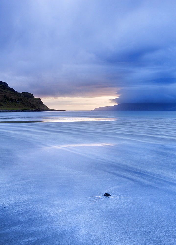 Early evening view towards Rum from the Bay of Laig on a stormy evening on the Isle of Eigg, Hebrides, Scotland, United Kingdom, Europe