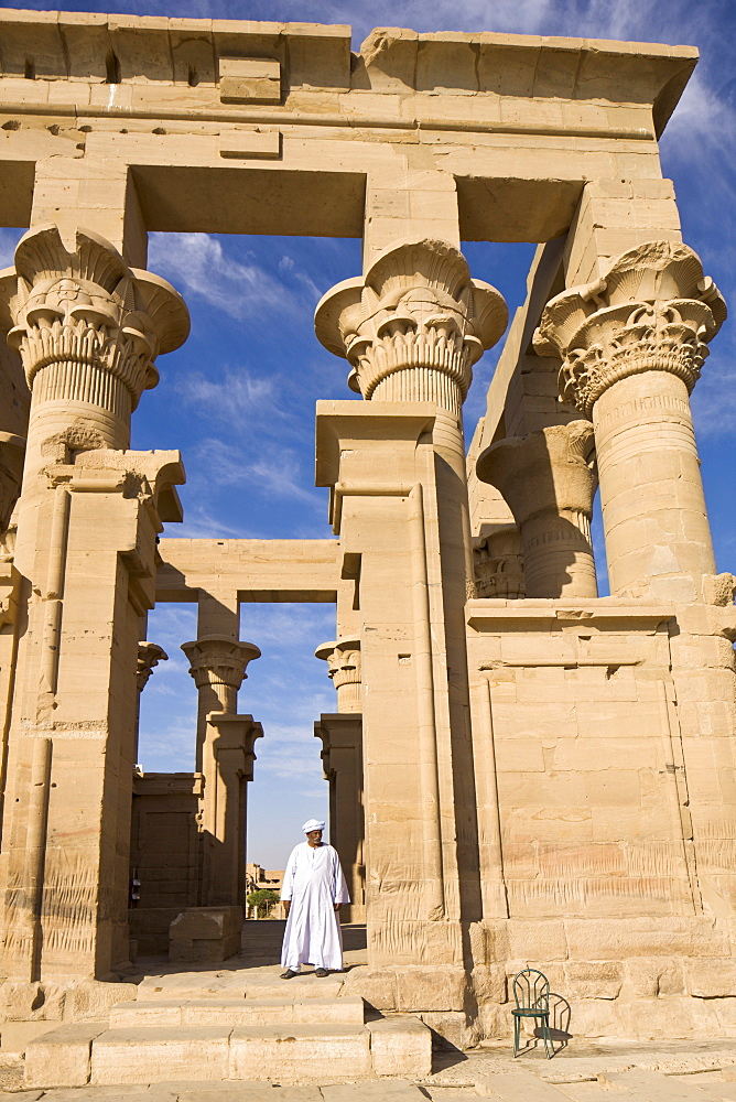 Man in white jellabiya in front of the Kiosk of Trajan at the Philae Temples, UNESCO World Heritage Site, Nubia, Egypt, North Africa, Africa