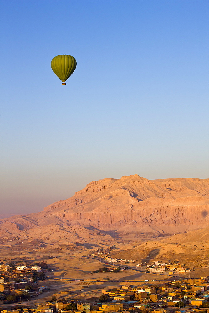 Hot air balloon suspended over the Theban hills of Luxor, Egypt, North Africa, Africa