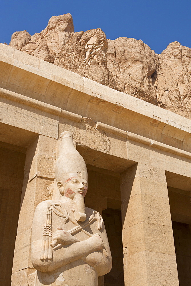 Osirian statue of Queen Hatshepsut on the upper portico of her Mortuary Temple, Deir el-Bahri, Thebes, UNESCO World Heritage Site, Egypt, North Africa, Africa