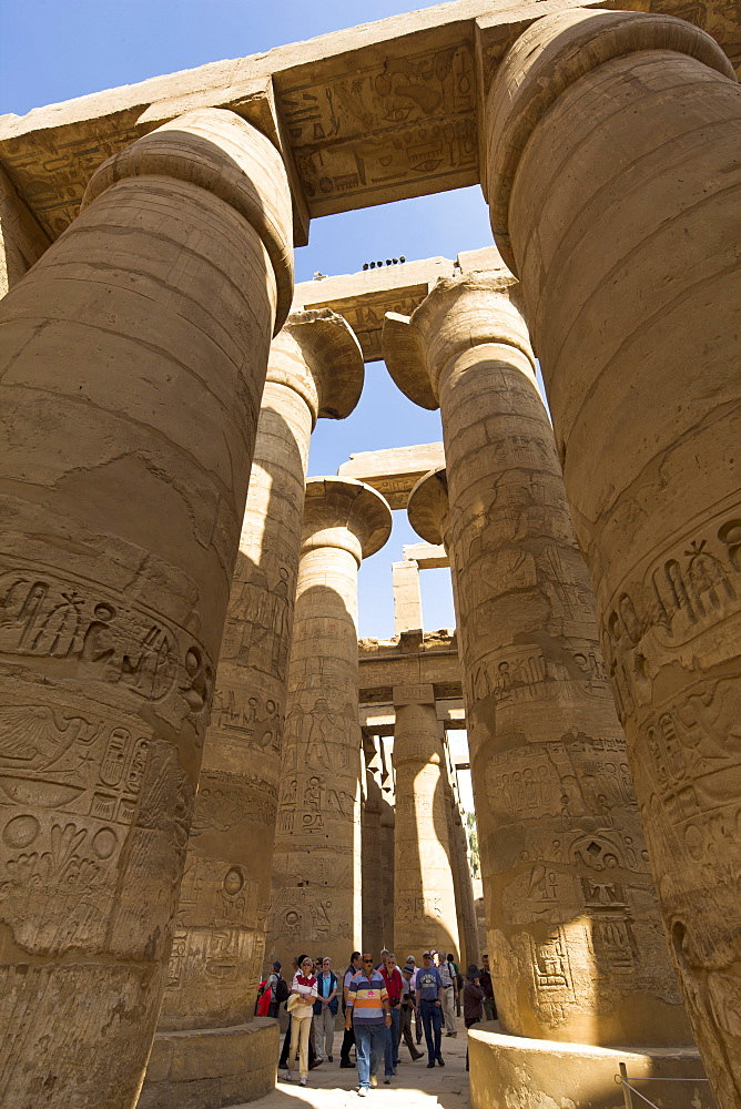 Tourists dwarfed by the towering columns of the Great Hypostyle Hall of the Karnak Temple of Amun, Thebes, UNESCO World Heritage Site, Egypt, North Africa, Africa
