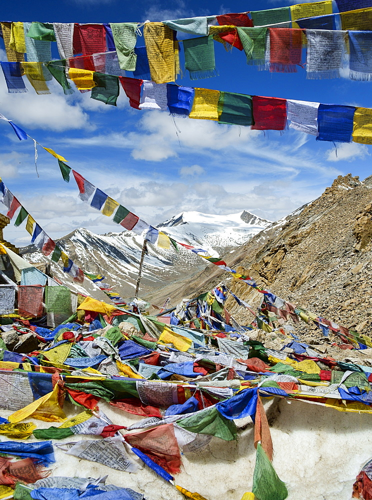 Prayer flags at Khardung La mountain pass. the highest road pass in the world, Ladakh, Himalayas, India, Asia - 847-475