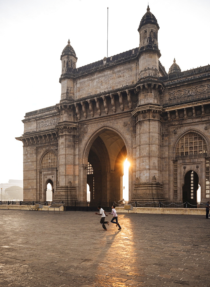 Sunrise behind The Gateway to India, Mumbai (Bombay), India, South Asia