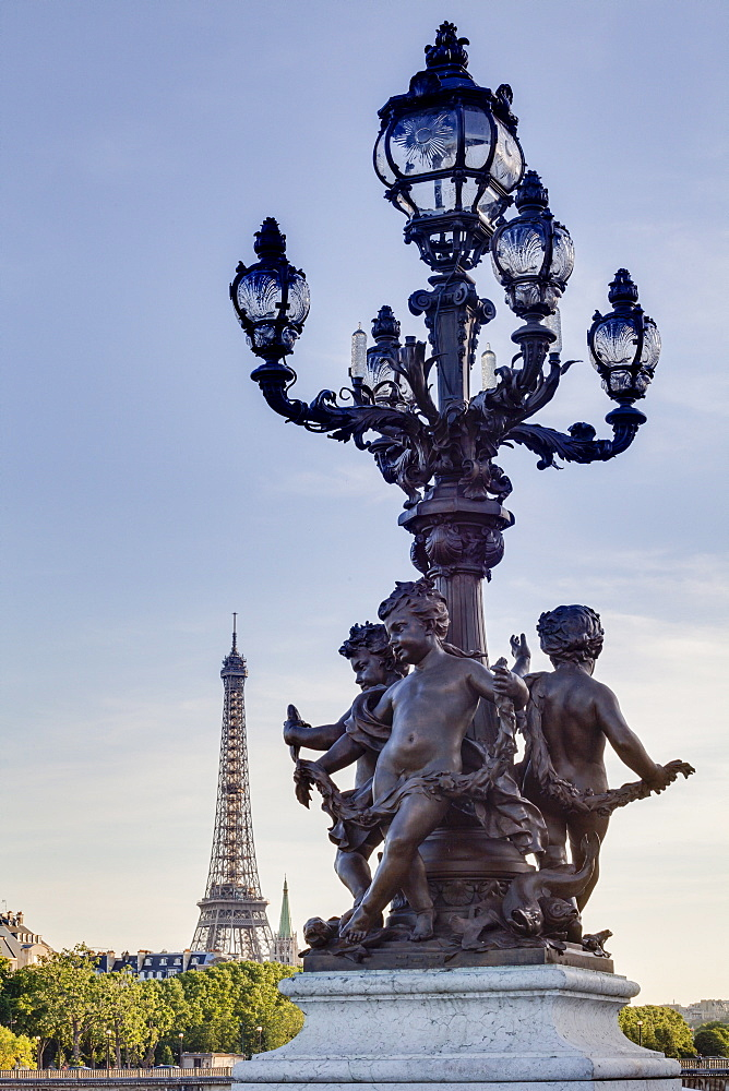 Statues on Pont Alexandre III with the Eiffel Tower in the background, Paris, France, Europe