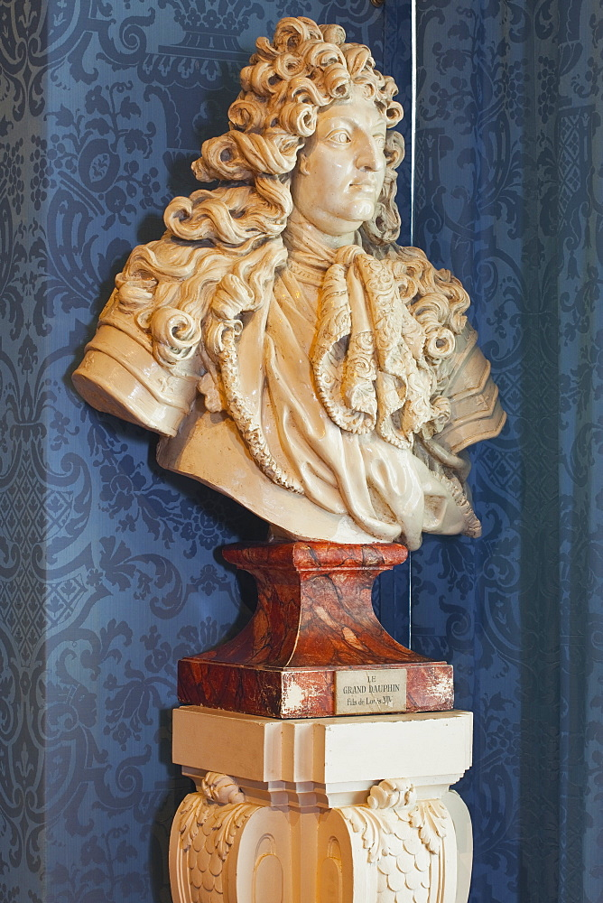 A bust of the Grand Dauphin (Louis de France) watches out of a window in the Chateau de Chambord, UNESCO World Heritage Site, Loir-et-Cher, Centre, France, Europe