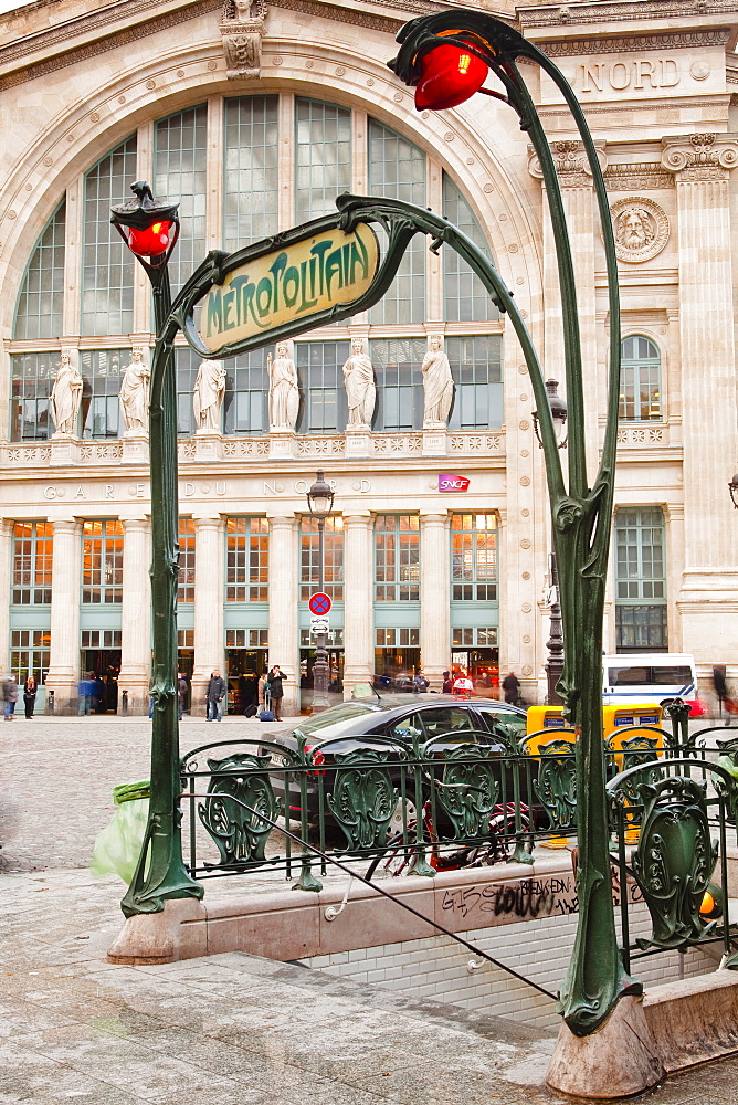 The art nouveau entrance to Gare du Nord metro station with the main railway station behind, Paris, France, Europe