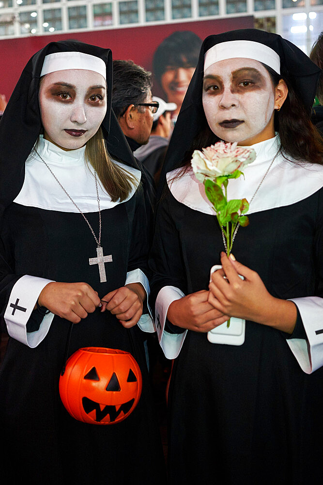 Young Japanese girls dressed as nunsat the Halloween celebrations in Shibuya, Tokyo