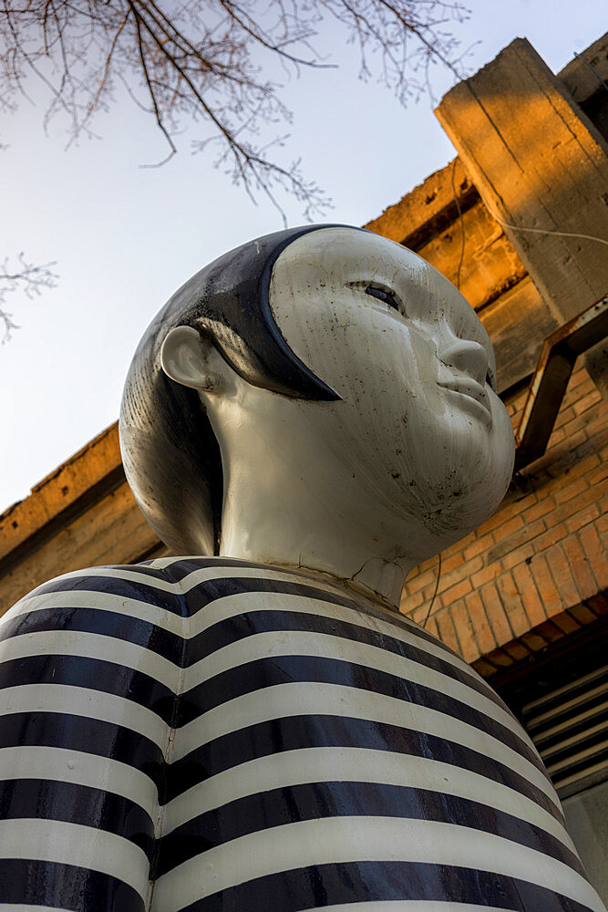 Girl sculpture at the 798 Art Zone (Dashanzi Art District) in Beijing, China, Asia
