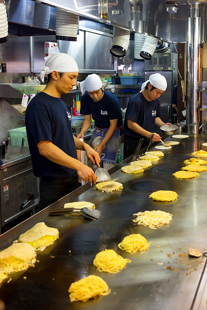 Okonomiyaki being prepared in a restaurant in Hiroshima, Japan, Asia