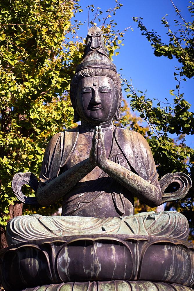 Kannon Bosatsu Buddha sculpture at the Sensoji Temple in Asakusa, Tokyo, Japan, Asia