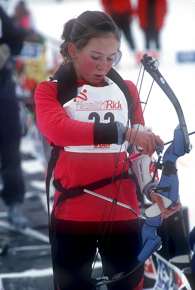 A Young participant in the relatively new sport of Ski Archery, a sport similar to biatholon but with archery instead of rifles, prepares to take aim on a course in Park City, Utah