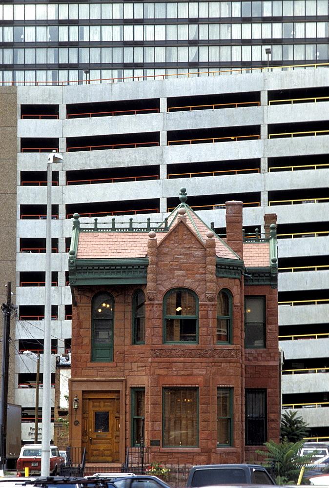Victorian-era building and modern architecture in Denver, Colorado