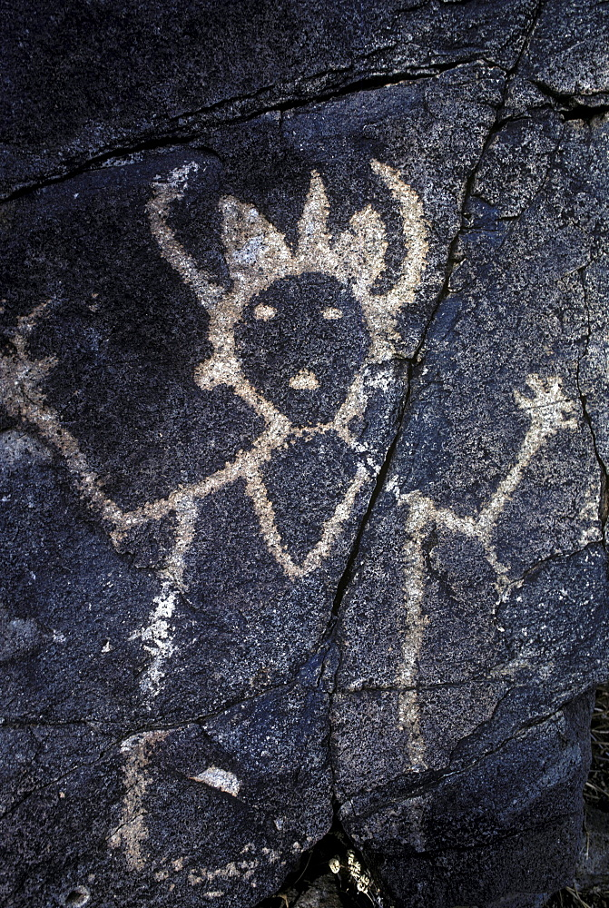Prehistoric Indian petroglyphs on a volcanic ridge in the Galesteo Basin near Santa Fe, New Mexico