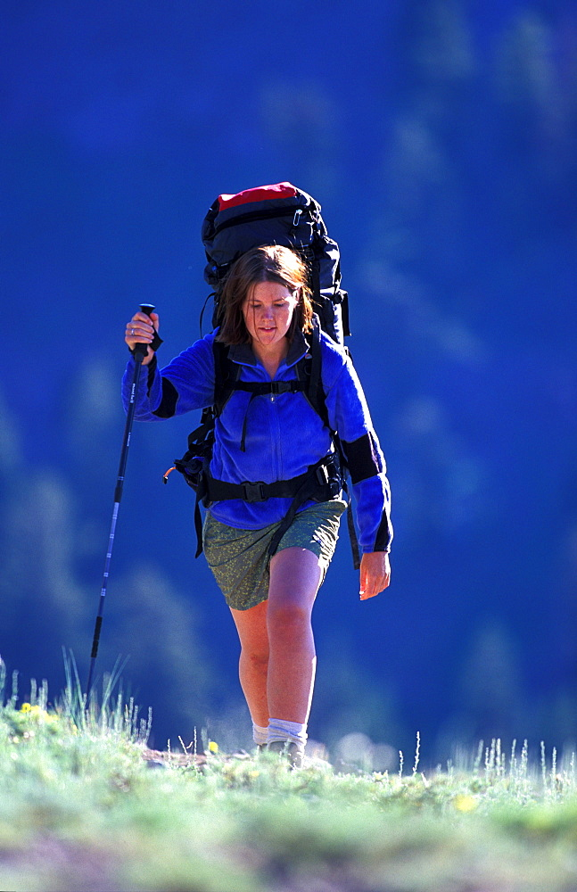 Kathryn Lessey hikes, backpacks in up hill at Kirkwood, California. Kirkwood is considered part of the Lake Tahoe region.