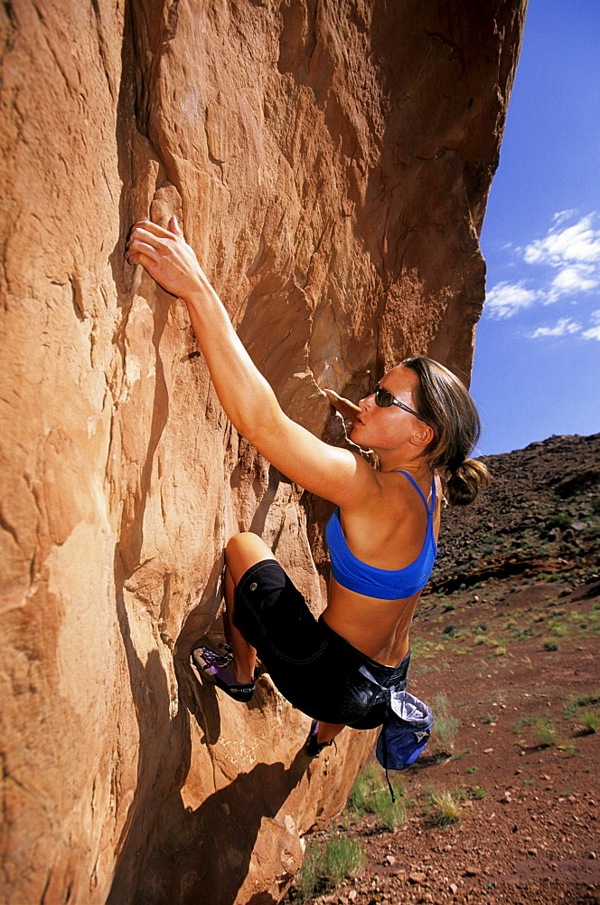 Charlotte Moats rock climber bouldering in the desert of Moab, Utah.
