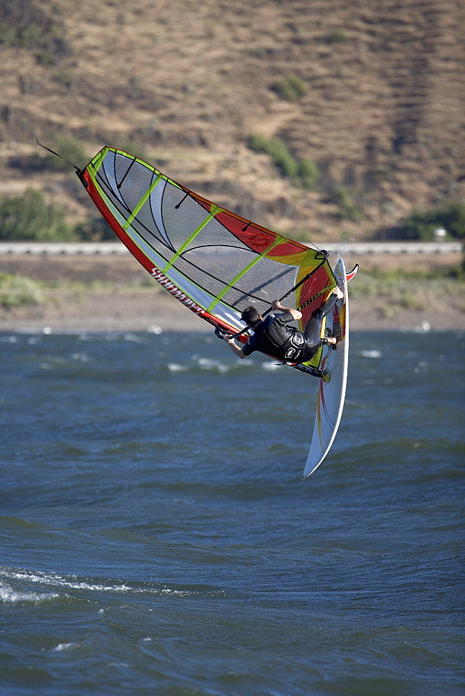 Mark Anderson showing reslove as he completes a back loop on the Columbia River near Maryhill, WA