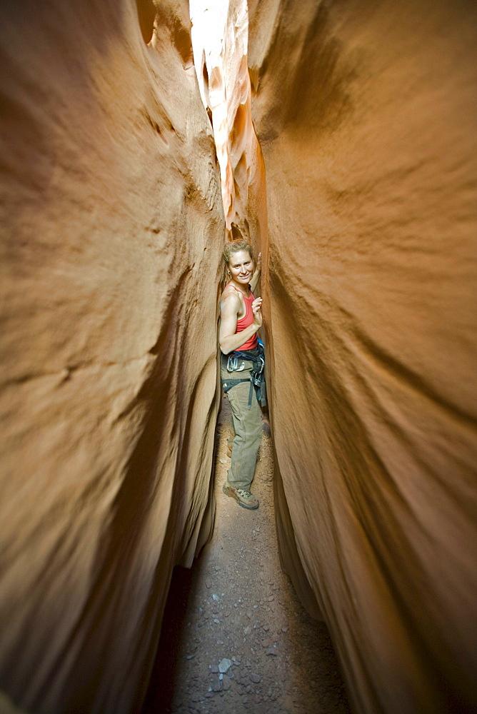 Lara Antonelli descending the main fork of Leprechaun Canyon also known as Shimrock, North Wash, Utah