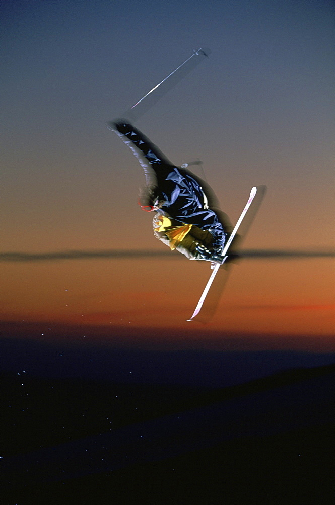 Skier catches air at sunset