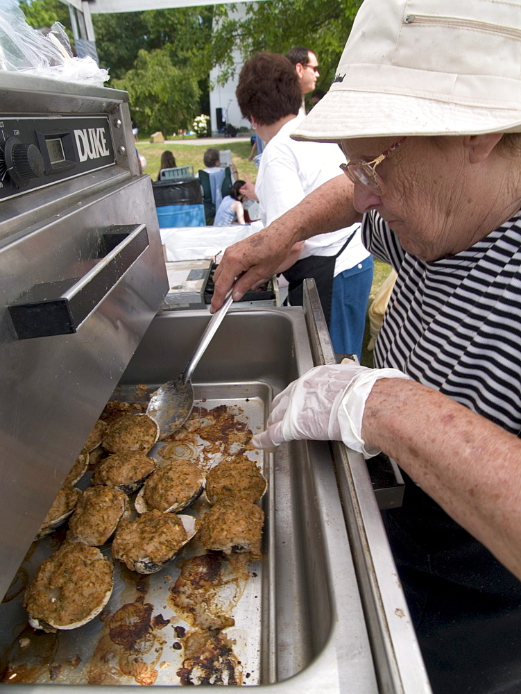 Warren, RI, 7, 16, 05: Vendors unpack, bake and sell premade stuffed Quahogs as part of the Warren Quahog festival (a community fundraiser) in Warren, Rhode Island.
