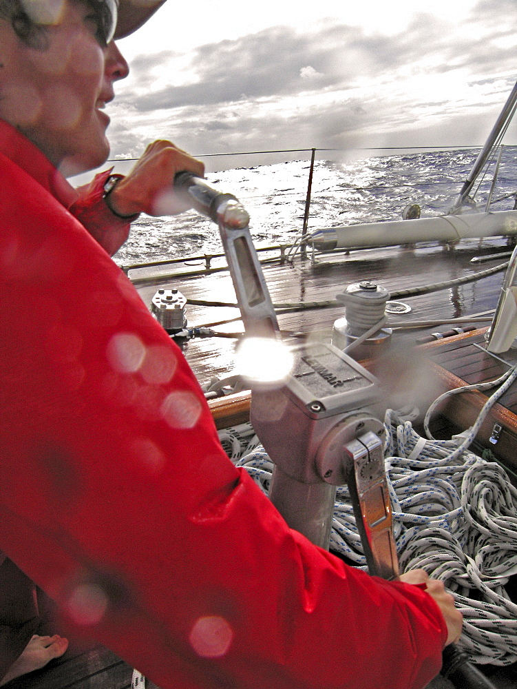 Cody Field grinds in the headsail aboard Endeavour while sailing from Newport, RI to Antigua, West Indies on the Atlantic Ocean.