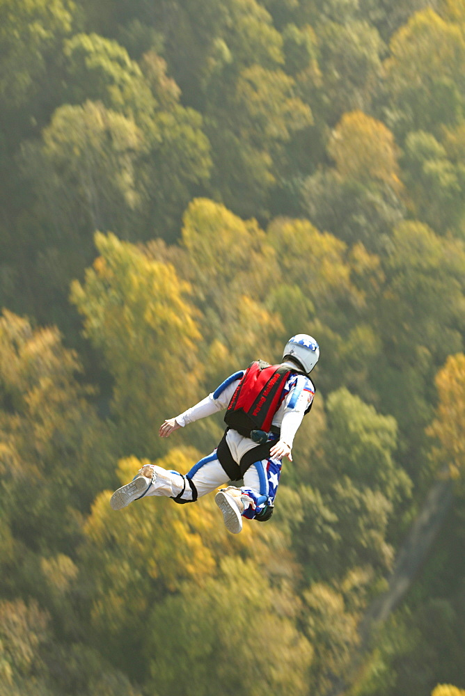 Unknown Base Jumper leaps off the Rt. 19 bridge over the New River Gorge at Fayetteville, WV for the Annual Bridge Day event.