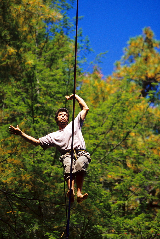 Bart Bledsoe walks a 100ft long and 200 foot high slackline set up at Torrent Falls near Slade, KY.