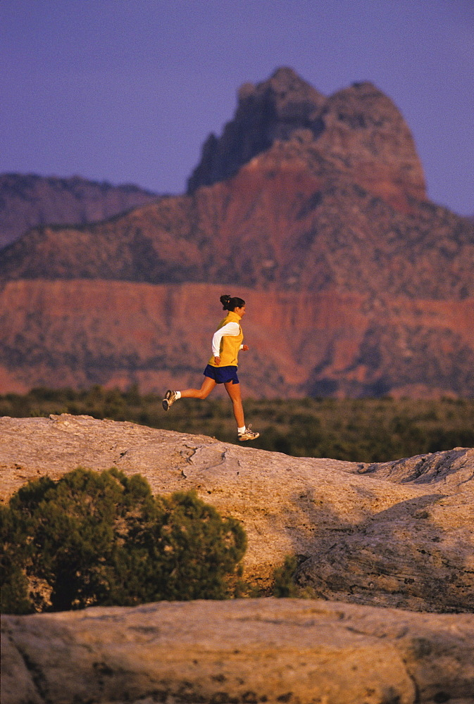 Talyn Villasenor runs on slickrock at Gooseberry Mesa in Southern Utah.
