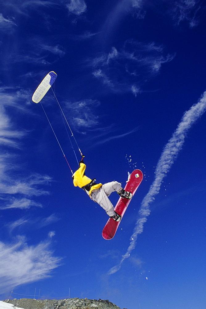 Luk Stanek kiteboarding at Blackcomb Mountain. Whistler, British Columbia, Canada.