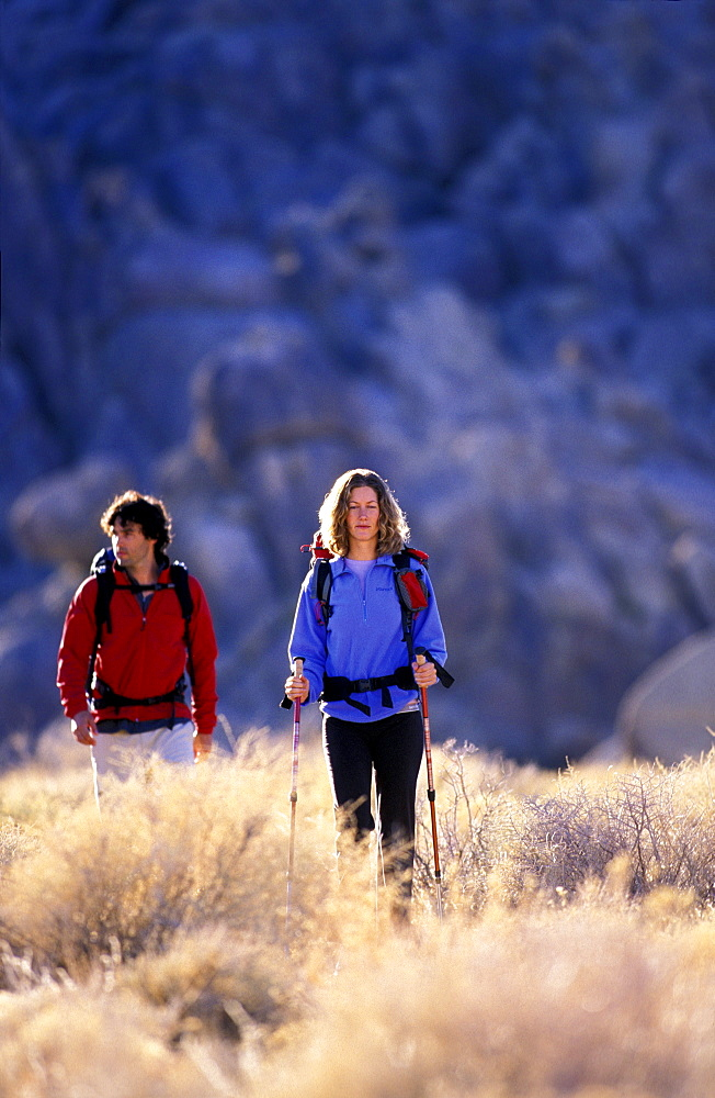 Ashley Loux and Tim Davis enjoy trekking, hiking, backpacking in the high desert outside of Lone Pine in California.