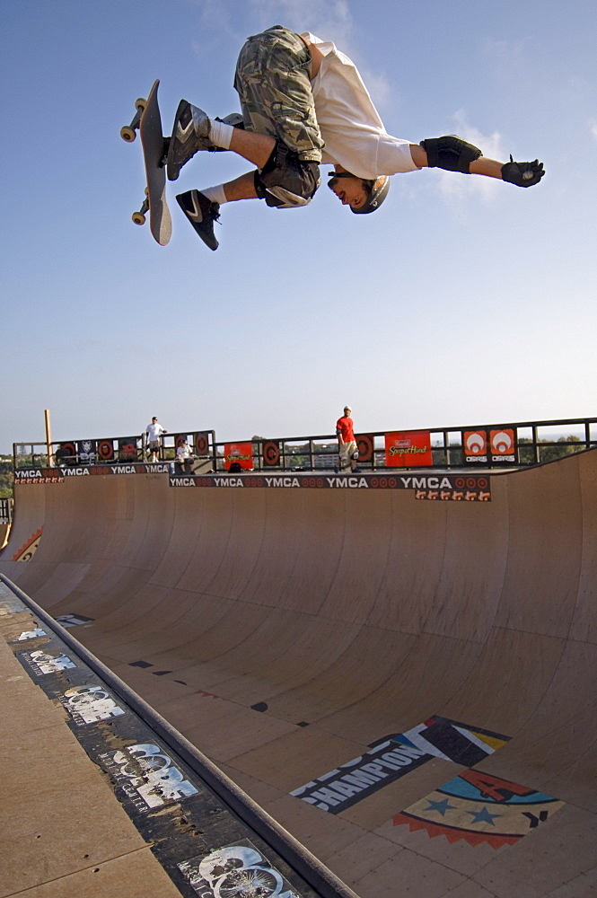 Pro skater Bob Burnquist practicing a trick on his skateboard shortly before a big competition in a skatepark in Encinitas. The skatepark was designed by legendary skateboarder Tony Hawk. California, USA.