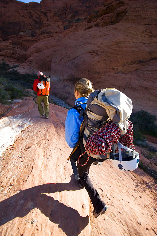 Couple hiking/rock climbing, Nevada