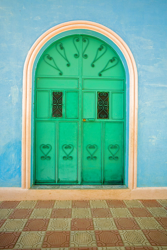 A bright green door at an entrance to a church Santa Cruz, Guatemala