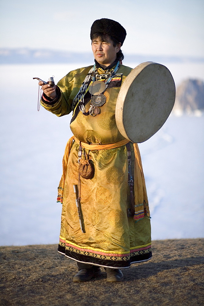 A Shaman performs a ceremonial ritual on Olkhon Island, Siberia, Russia.