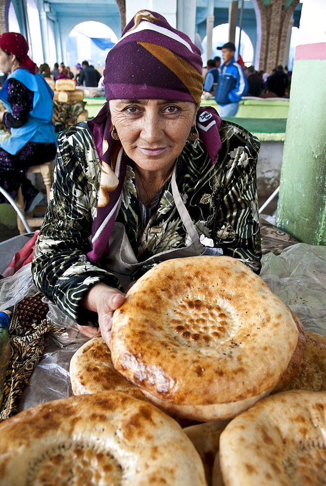 Traditional bread vendor in a market of  Samarkand, Uzbekistan