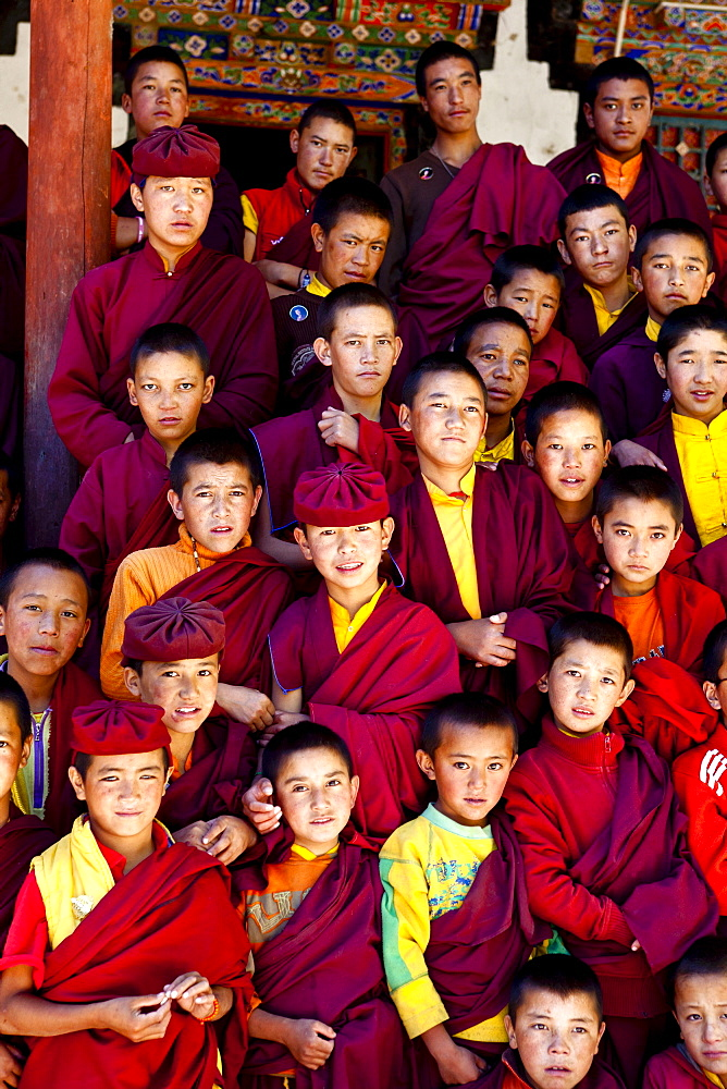 India, Jammu and Kashmir, Ladakh. A group of novice monks pose for a portrait at The Drukpa Kagyud Primary School. The school is part of Hemis Buddhist Monastery located 45 kilometers from Leh in Ladakh, Northern India.