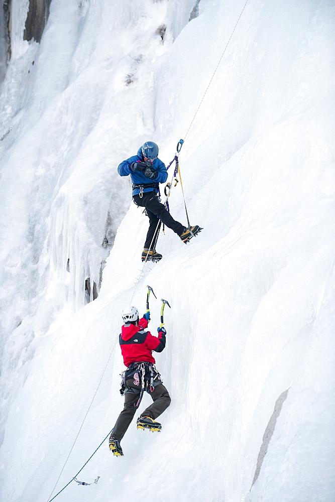 A photographer photographs an ice climber in Calif.