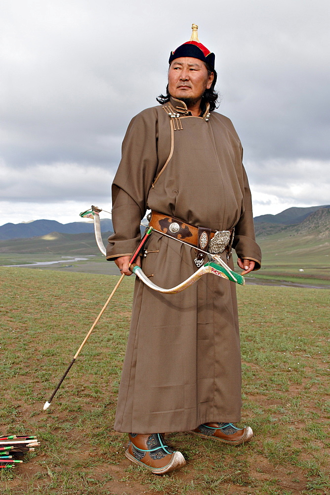 Mounted archer dressed as Genghis Khan. Orkhon Valley, Central Mongolia.