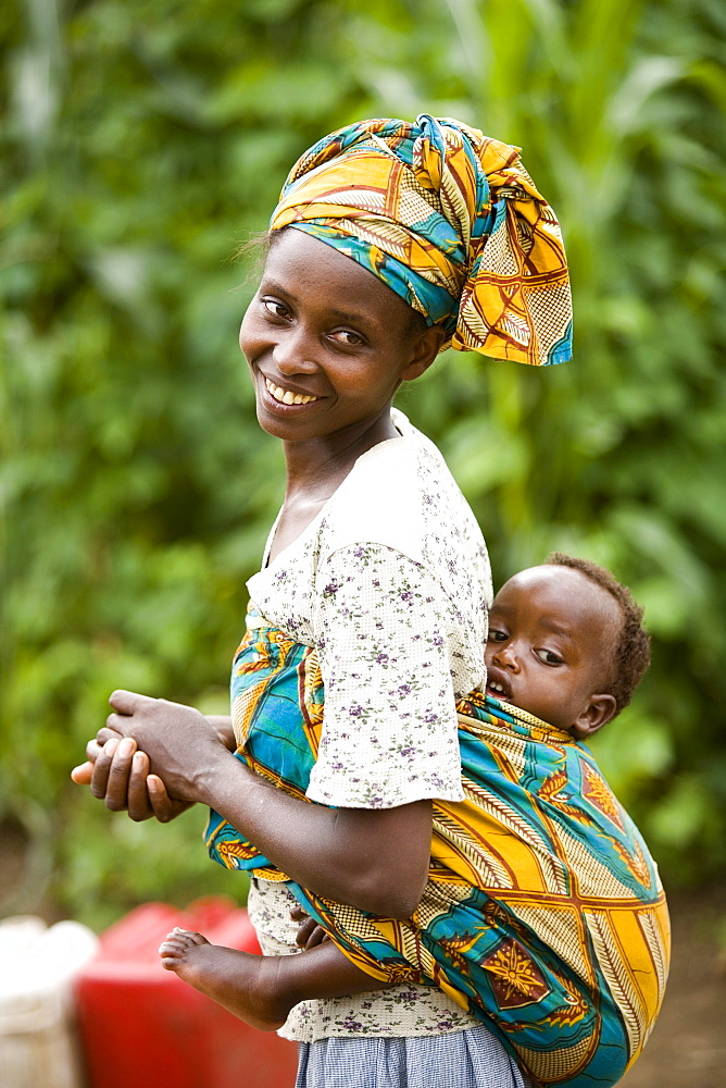 Rwandan woman carrying her child on her back.