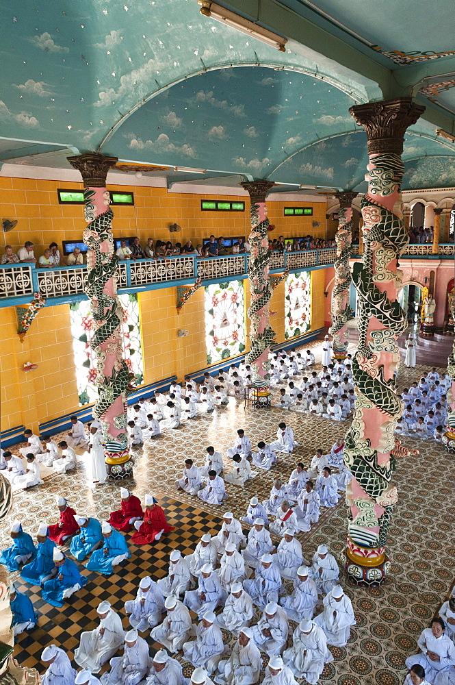 Religious ceremony, Cao Dao Temple, Vietnam.