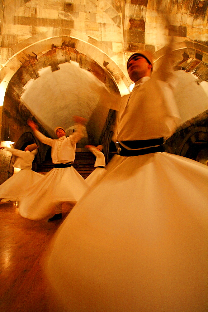 Whirling Dervishes: Men twirl in long whit robes as a part of a traditional Turkish Sema (ceremony).