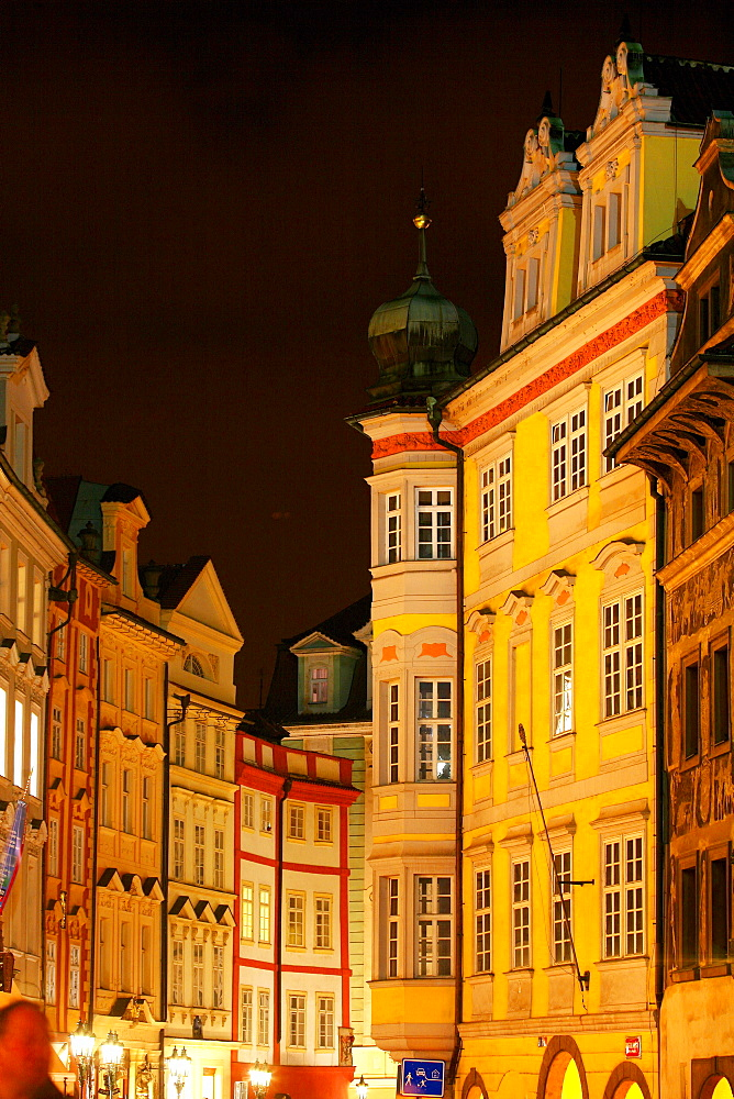 Staromestske namesti, an old town square in the historic section of Prague at night.