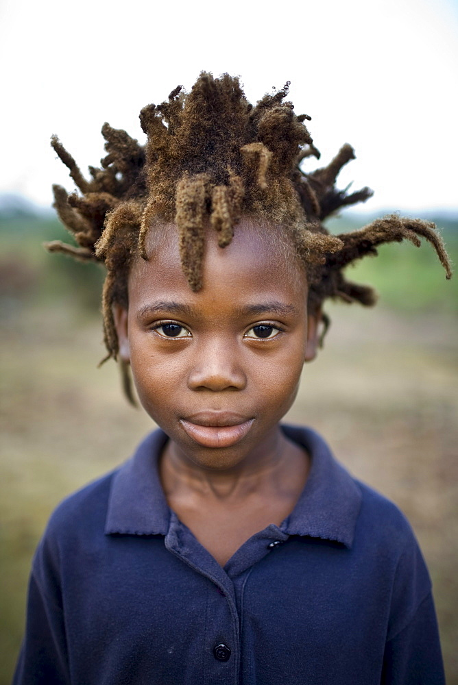 Portrait of a young african boy with wild spiky hair.